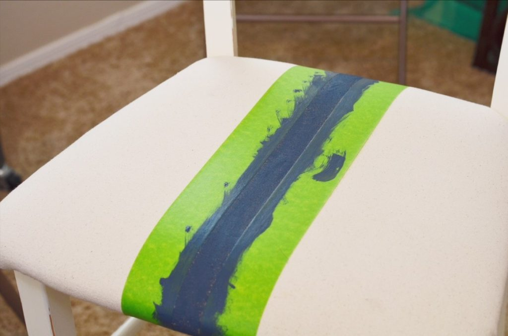 Farmhouse stripe on bar stool seat covered with drop cloth fabric.
