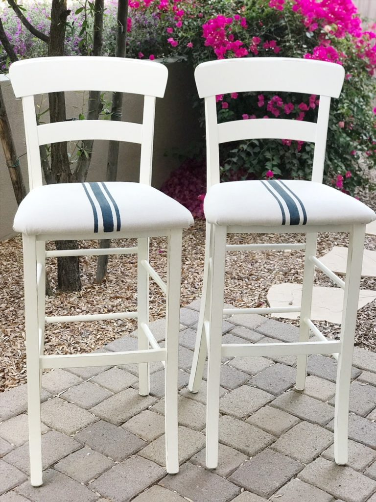 Boring Bar Stools become Farmhouse Favorite with chalk paint, drop cloth and grain sack stripes.