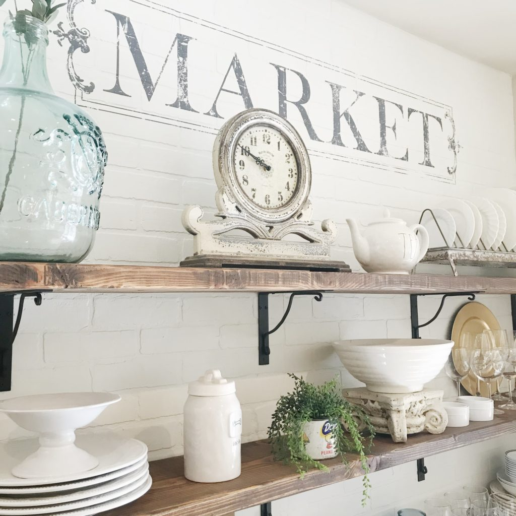 I love how the addition of faux brick, some brackets and shelves have transformed my kitchen from ordinary to extraordinary!