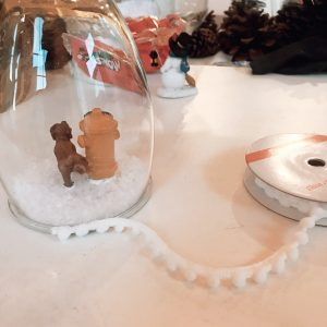 attach the decorative trim to your wine glass snow globe