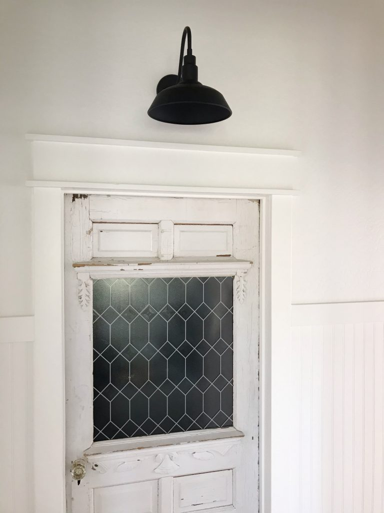 Adding a light above this farmhouse door is a fabulous way to showcase it and let its charming beauty shine!