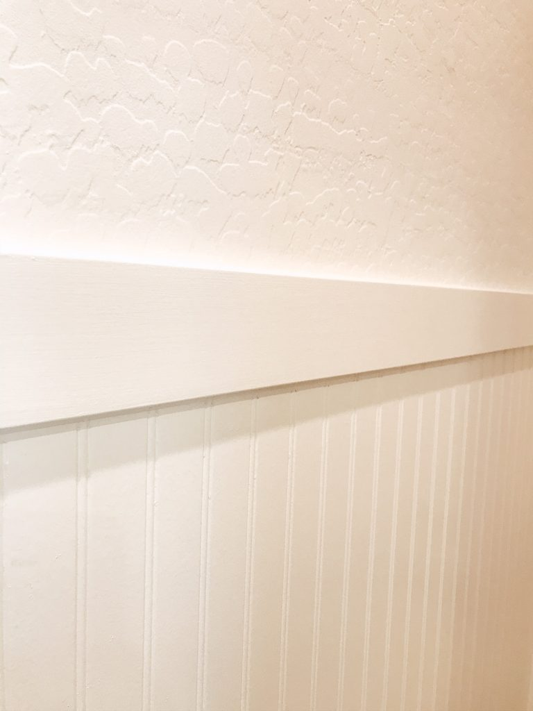 MDF works great for this project. I used 1x4 primed MDF to trim out the beadboard on the walls.