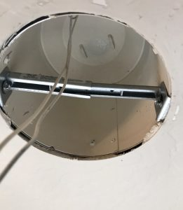 Fixture brace adapter in place in can light