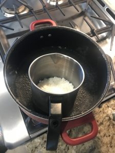 Melting the wax for your DIY candle