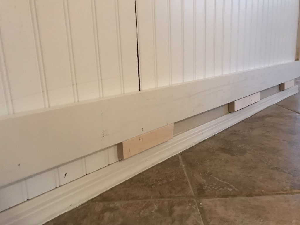 "Layering the new baseboard above the old using 4""MDF"