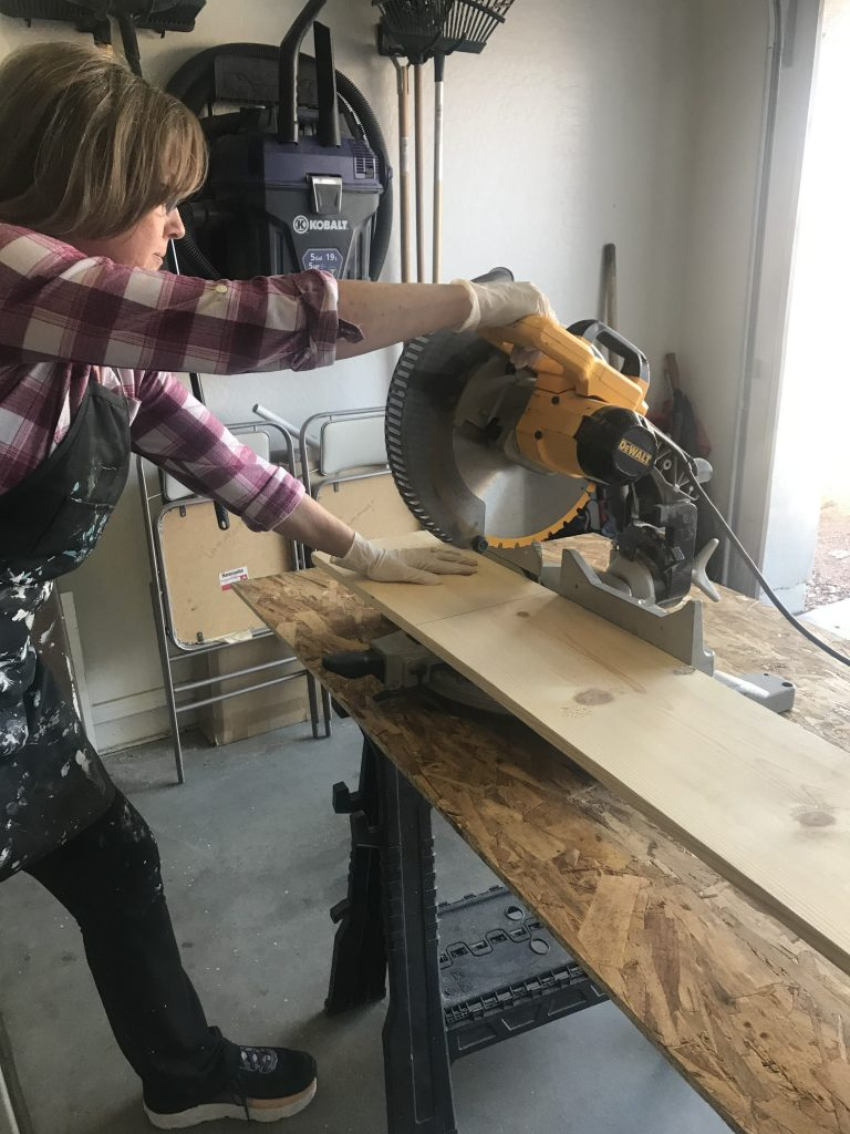 Cutting the 1x10 board with a miter saw