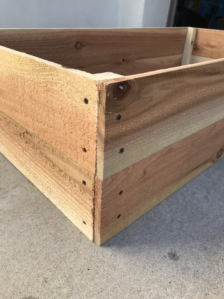 Cedar fence pickets attached with wood screws to a 12 ' 2x2