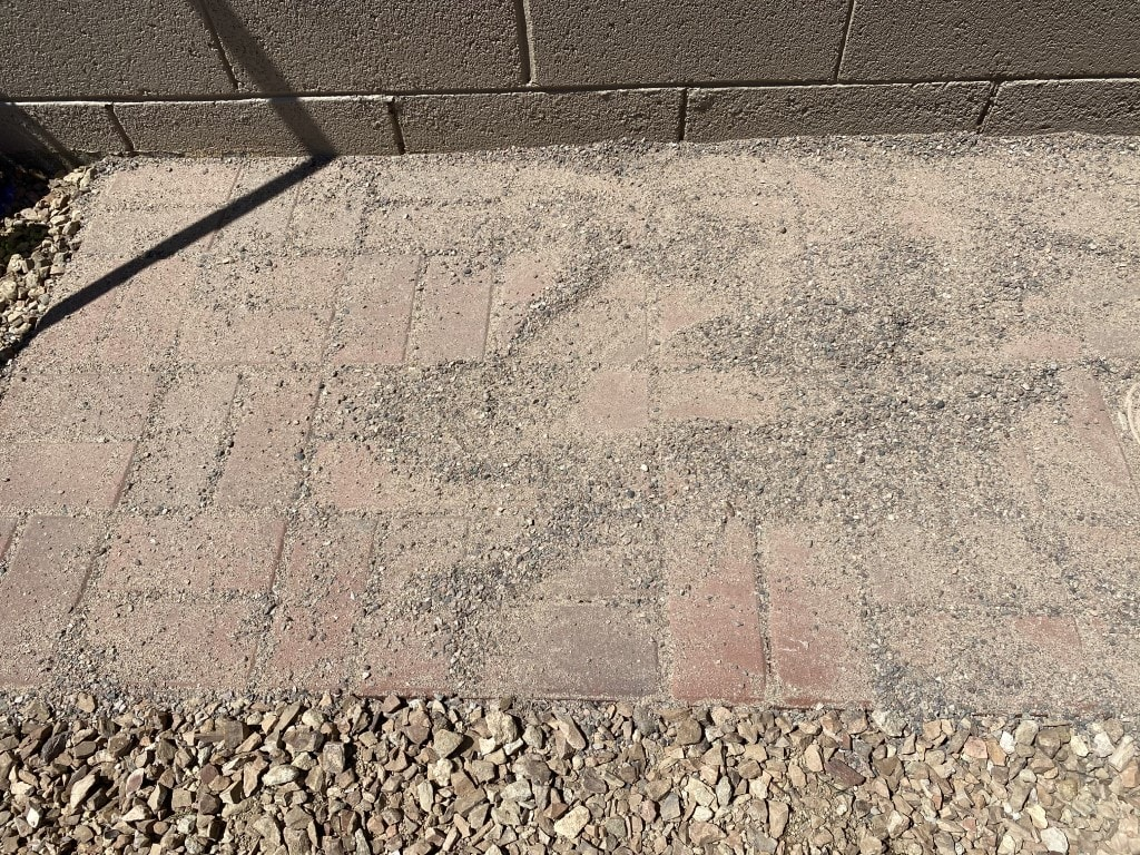 Brick potting bench pad covered in sand