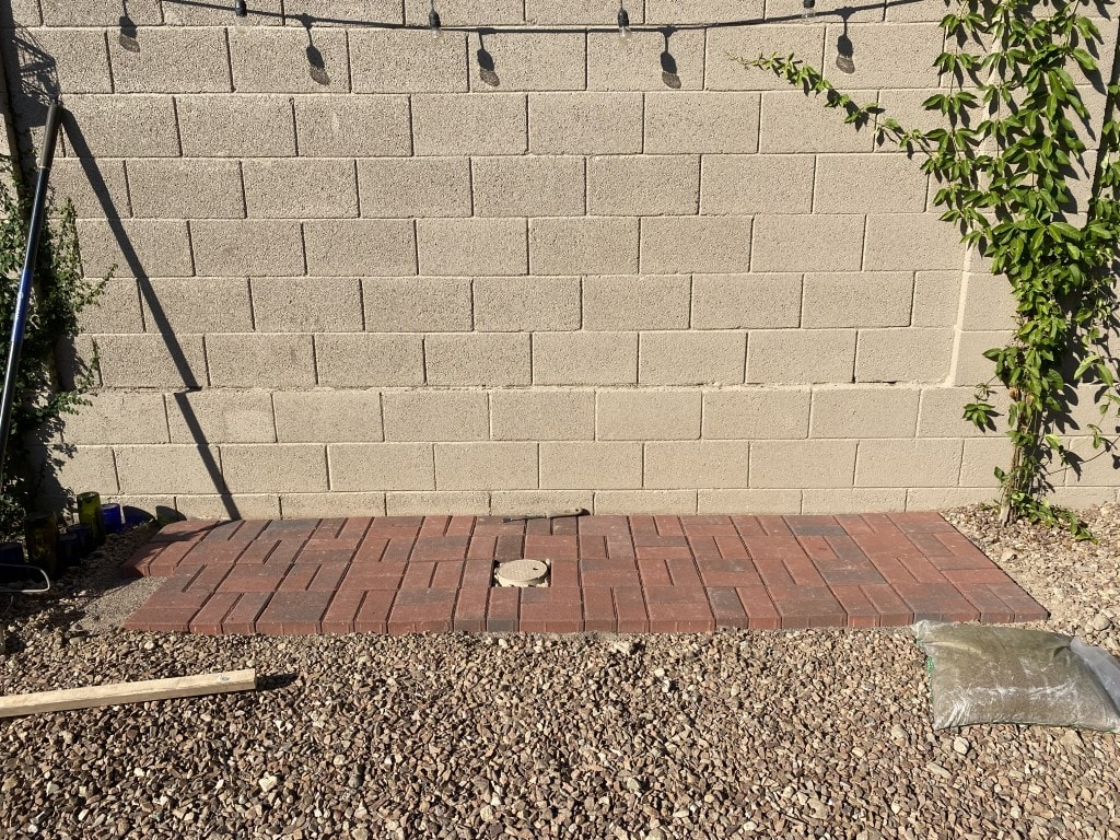 All the brick laid out except one corner