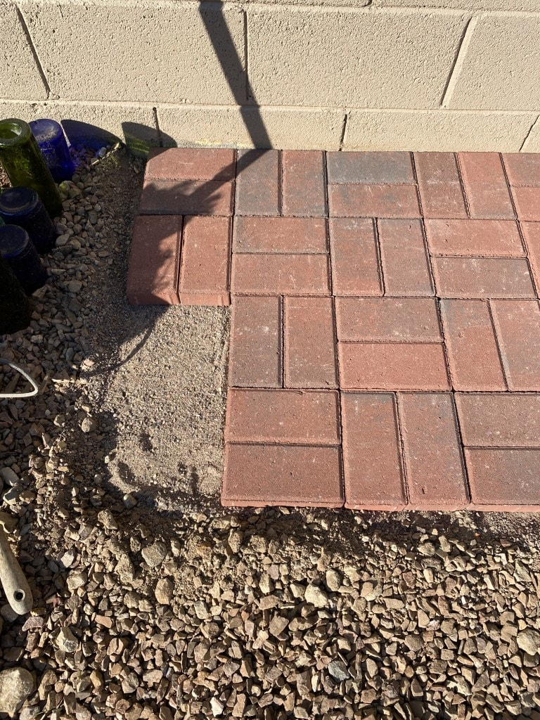 Just 4 bricks short of completing the potting bench pad