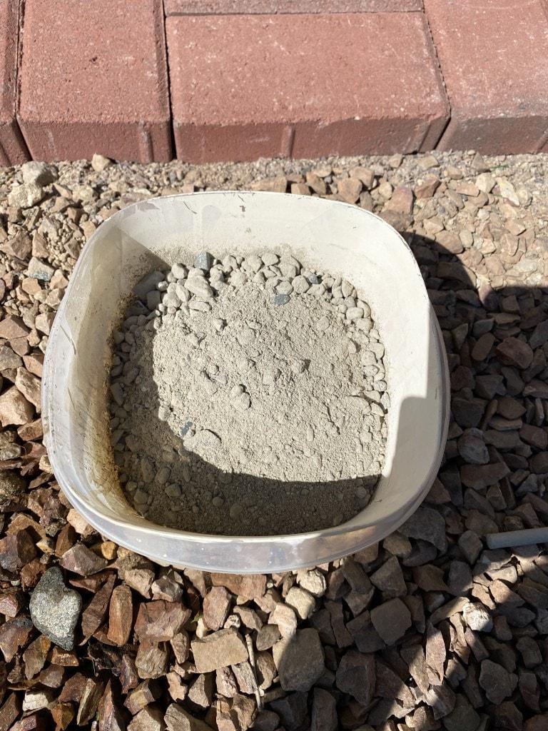 plastic bowl full of dry quikcrete