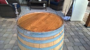 completed wine barrel top after applying epoxy resin
