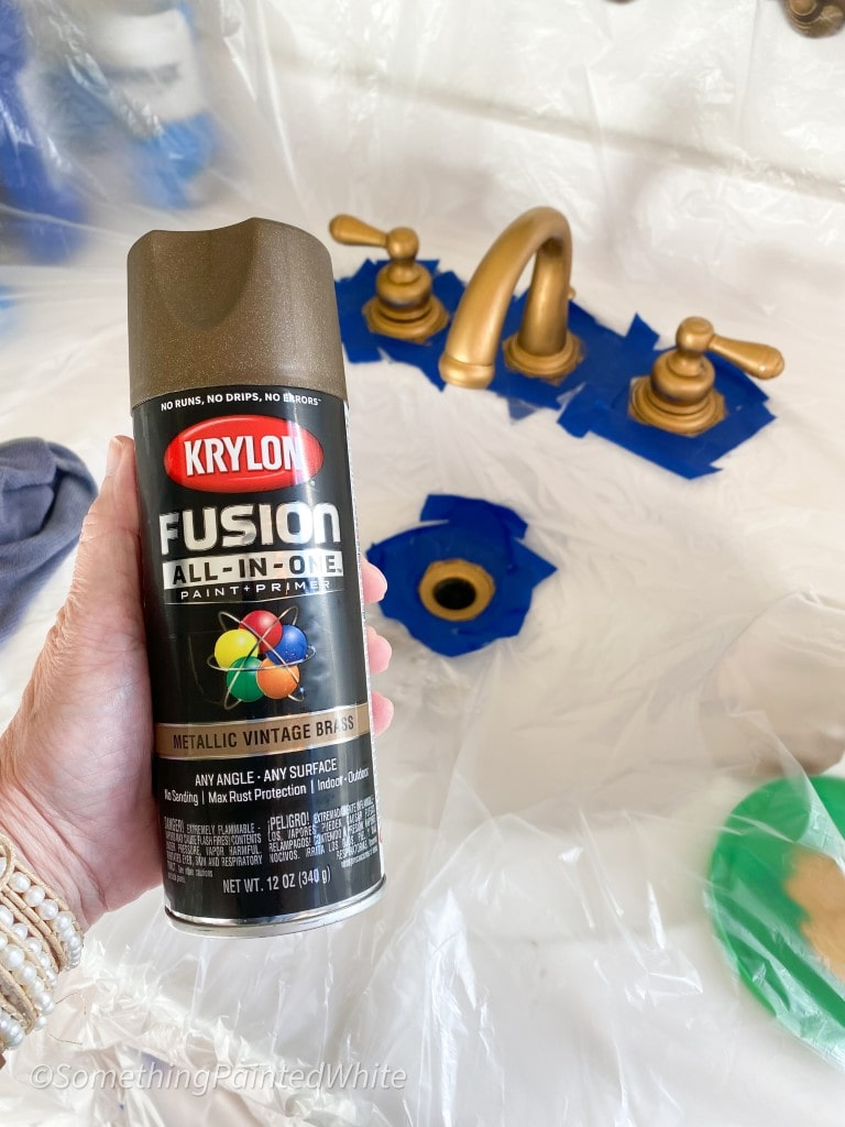 can of spray paint, preparing to spray paint the faucets