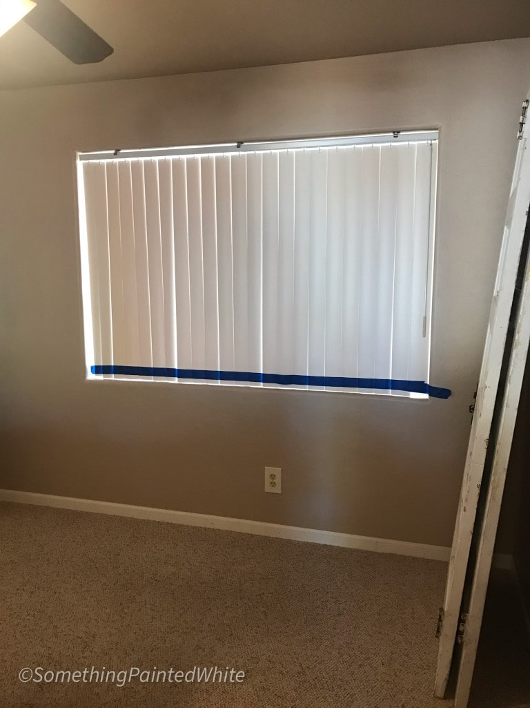 Blinds closed and taped to hold them in place
