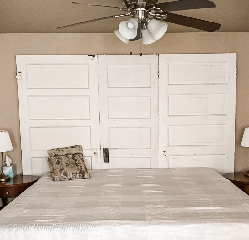 Vintage Doors used as a headboard with bed placed against them