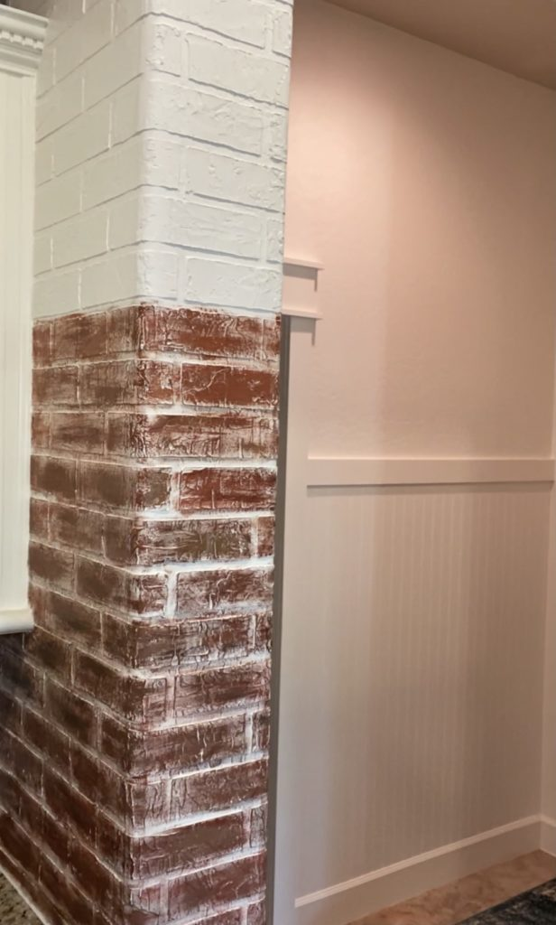 Painting the faux brick wall with 4 colors to make them look like authentic bricks