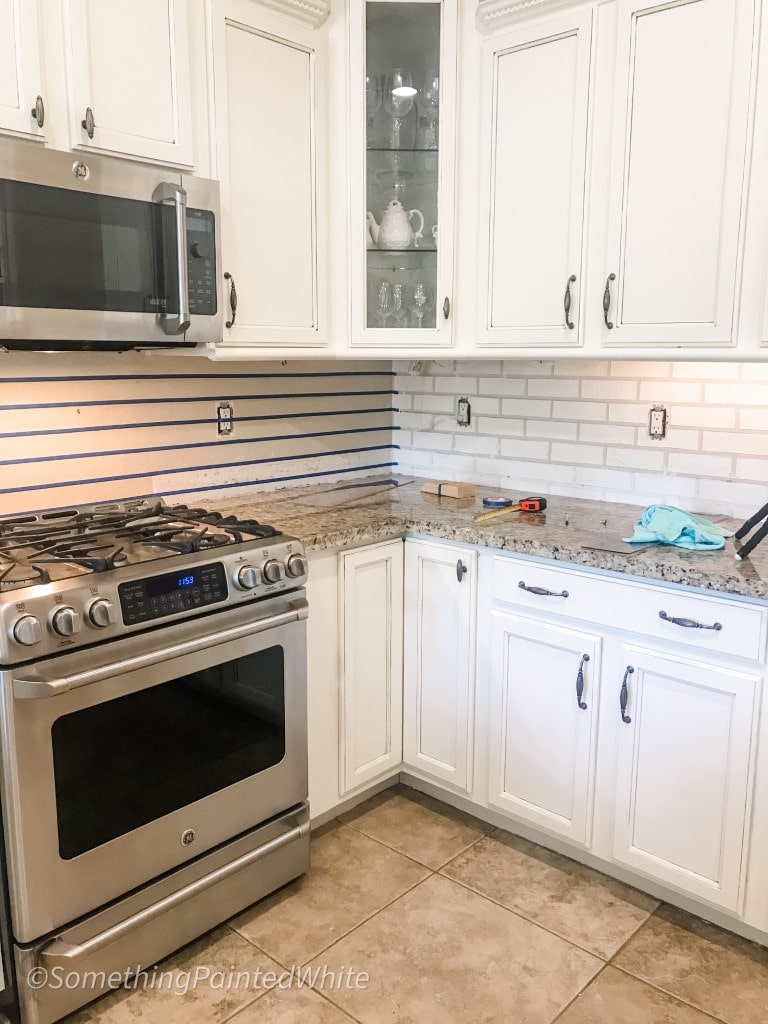 One backsplash with joint compound bricks finished, other wall is in the taping process with horizontal tape lines.