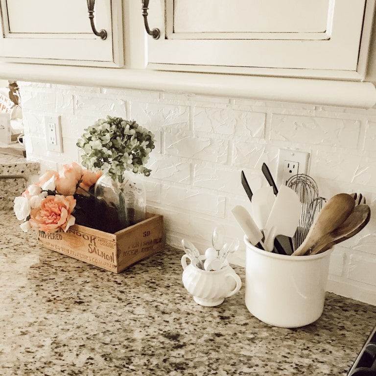 Faux brick wall on kitchen backsplash made from joint compound.