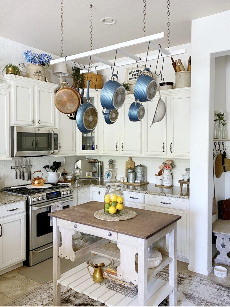 Photo of kitchen showing faux brick wall backsplash painted white