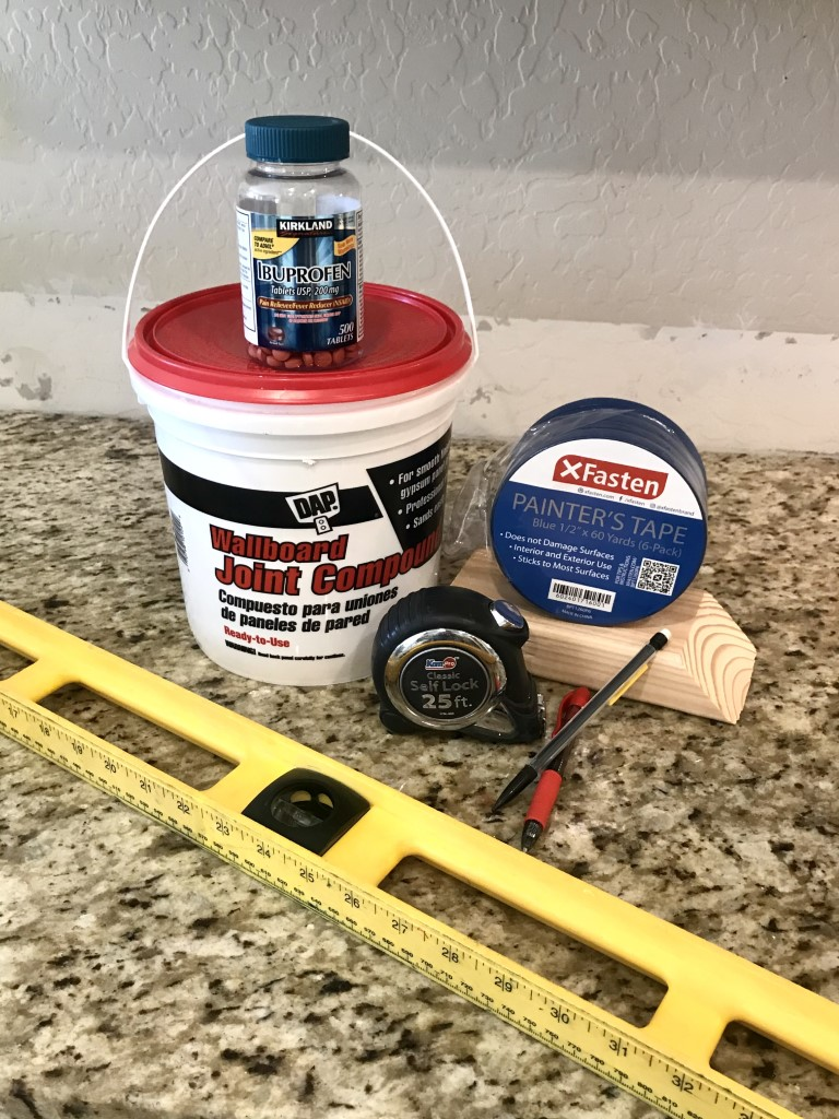 Supllies needed for faux brick. Joint compound, tape, measuring tape, pencil, level and ibuprofen!