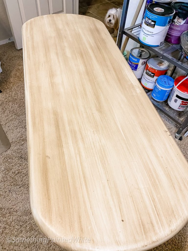 Top of the table after the glaze has been applied and then wiped with a rag to mimic wood grain.