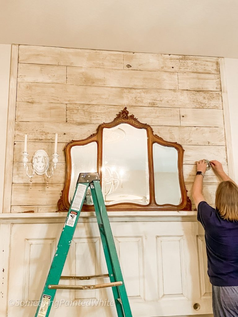 Starting the re-decorating process. by replacing the candle sconces and putting my recent FB Marketplace mirror on the headboard.