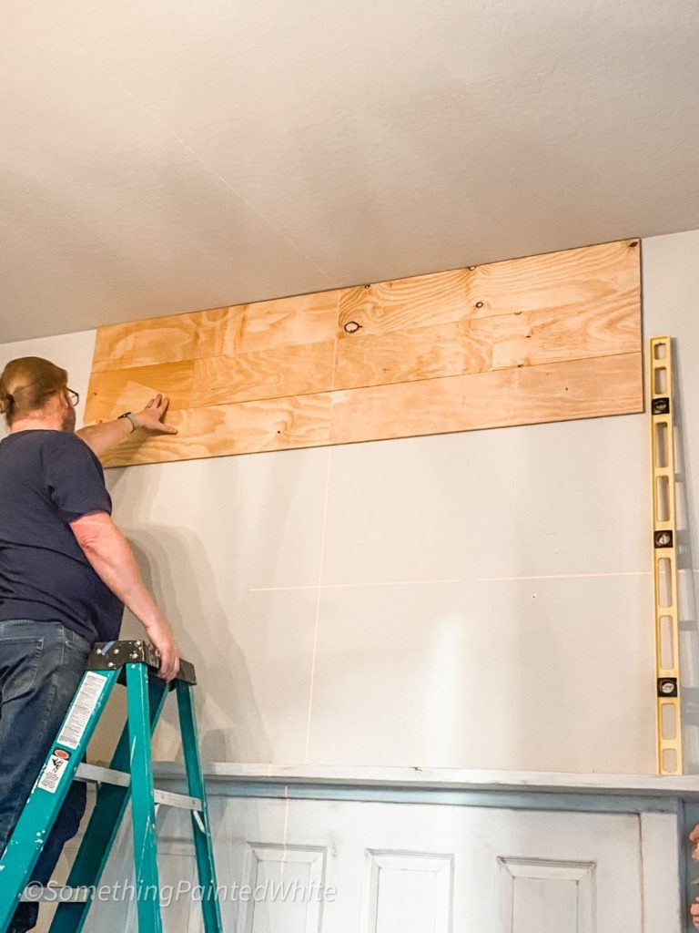 Adding floor board to the wall working from top to bottom!