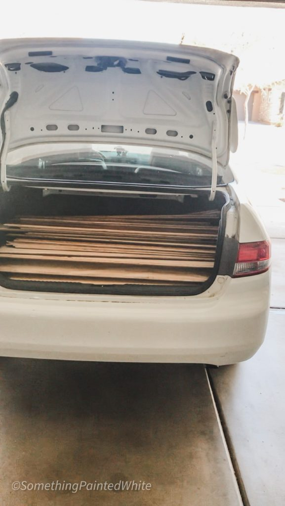 Honda Accord trunk full of wood flooring pieces to be used for a shiplap feature wall
