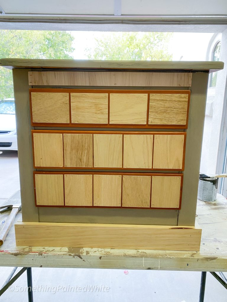 false drawers are all on. the top drawer is a bit different in size than the bottom two so the false fronts were cut accordingly to fit.