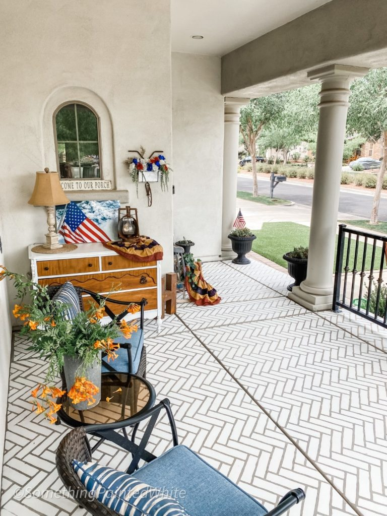 Showing the stenciled front porch after it is finished and decorated!