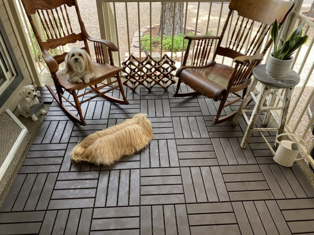 The dogs are enjoying the deck tile laid in a parquet pattern