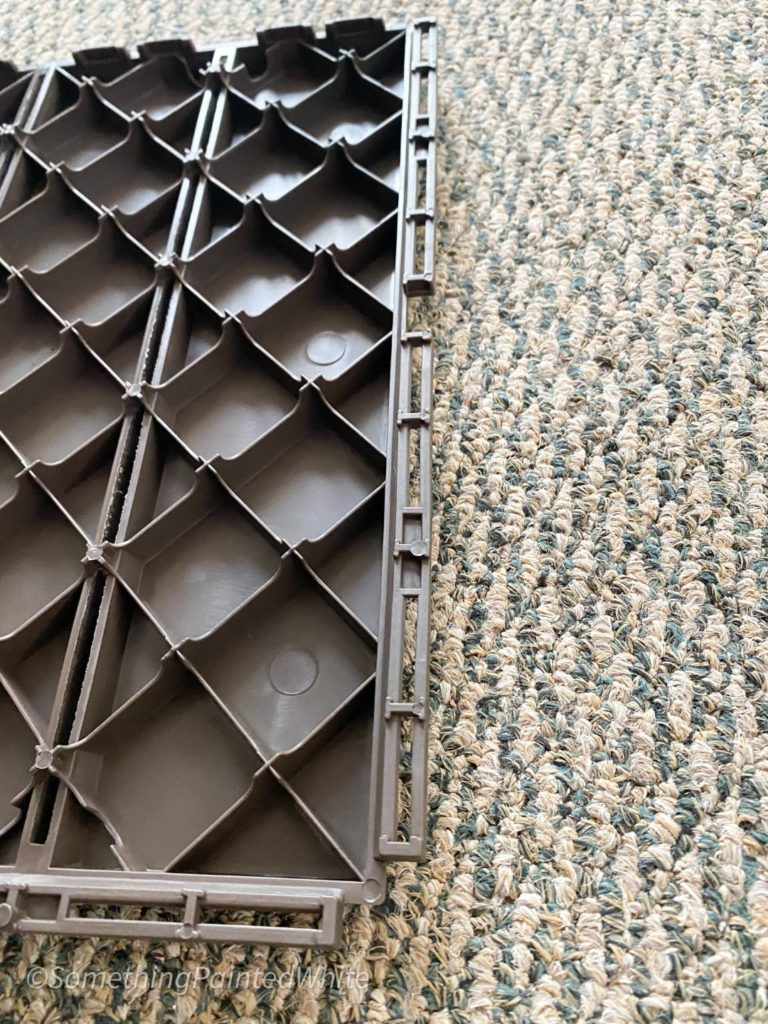 Showing the underside of the deck tiles before snapping them together.